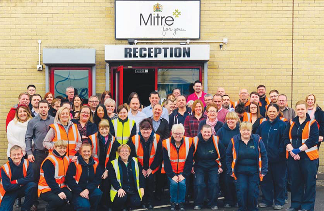 Mitre Linen Royal Warrent Staff Outside Reception